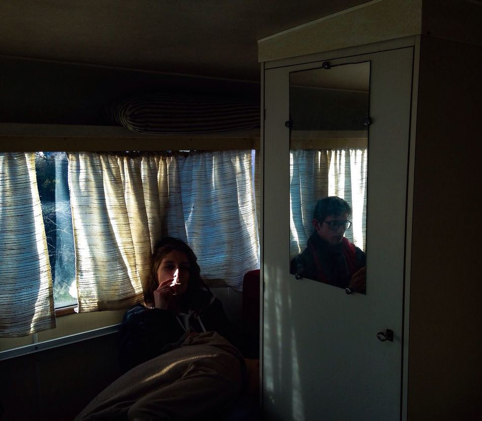 Youth is a strange path : most people need restrained spaces, rooms, to feel alright, while we're all claiming we need fresh air. Window Youth Of Today Indoors  Small Room Caravan Two People Reflection Scenics Light And Shadow Curtain Mood