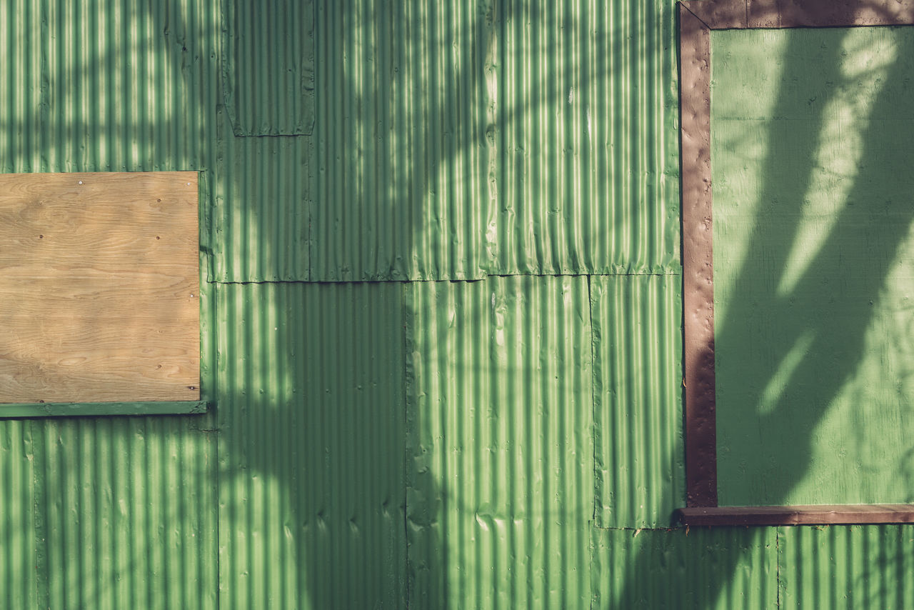 Casting Shadows Close-up Corrugated Iron Day Green Color Nature No People Outdoors Shadows Shadows & Lights Wall