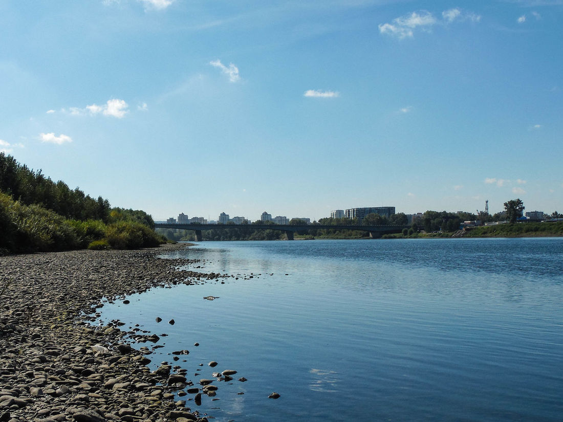 Beauty In Nature Blue Calm City Edge Cloud - Sky Day Nature No People Non-urban Scene Outdoors Remote River Riverbank Scenics Sea Shore Sky Tranquil Scene Tranquility Water Waterfront