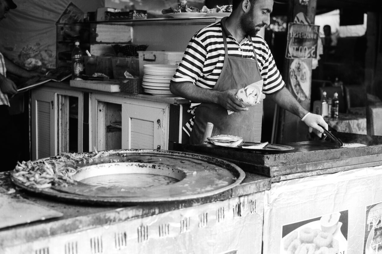 Street Photography in Istanbul Art B&w B&w Street Photography B&ww Casual Clothing Cook  Cooking Delicious Fish Islam Istanbul Istanbul Turkey Leisure Activity Middle East Muslim Part Of Preparation  Sandwich Skill  Street Photography Streetphoto Tasty Turkey Turkish Yum Welcome To Black