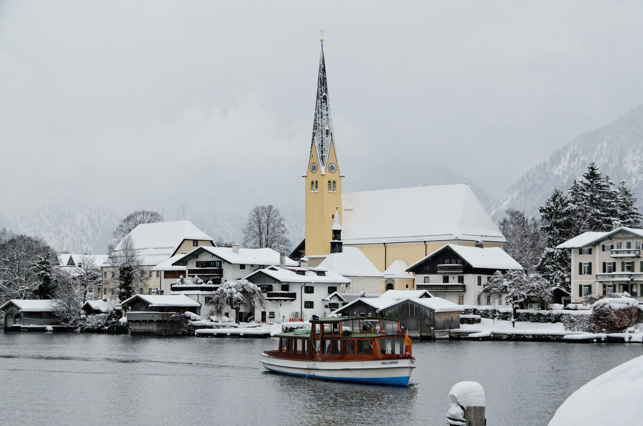 cold temperature, winter, architecture, built structure, building exterior, weather, religion, day, water, place of worship, snow, outdoors, spirituality, mountain, sky, nature, nautical vessel, no people, fog, travel destinations, tree