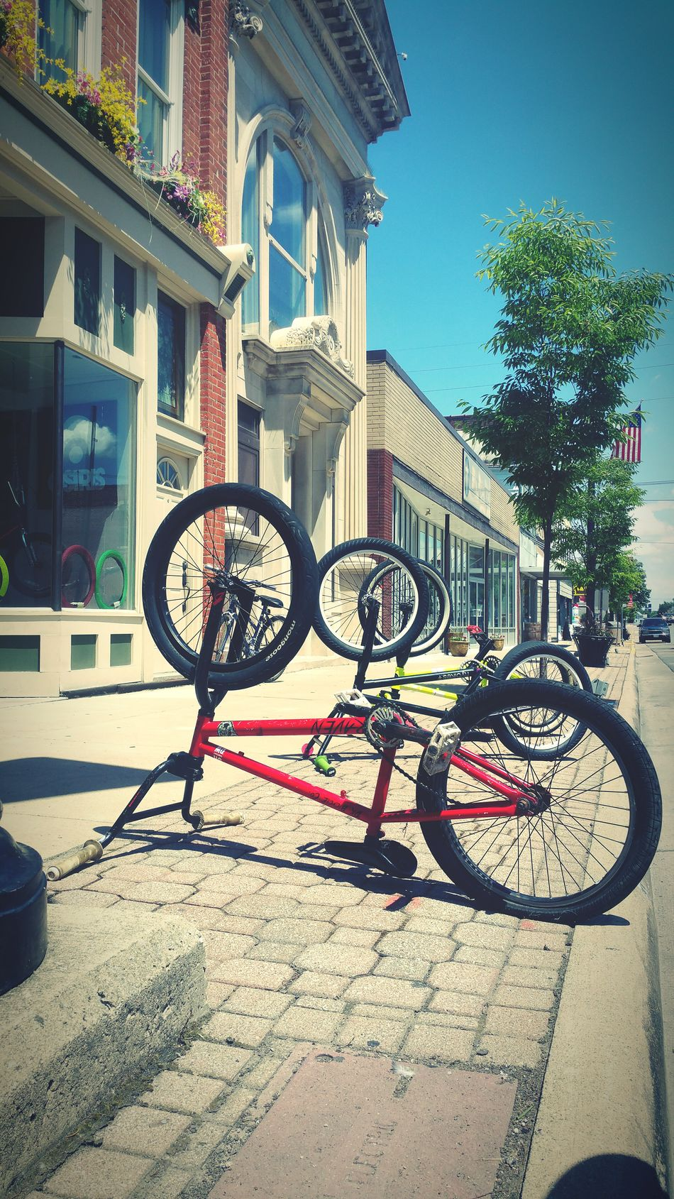 Parking at our local skate shop Bikes Skate Shop Downtown Sidewalk View