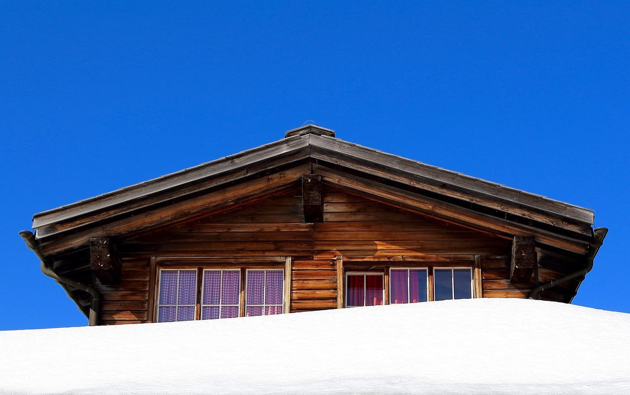 Swiss Chalet. Blue Blue Sky Copy Space Snow ❄ Snow Day Snow Covered Sky Chalet Wood Wooden Wooden House Hut White Brown Cosy Horizontal Winter Hiding Lines Parallel Lines Minimalism Minimalobsession Minimalist Windows Blue Wave