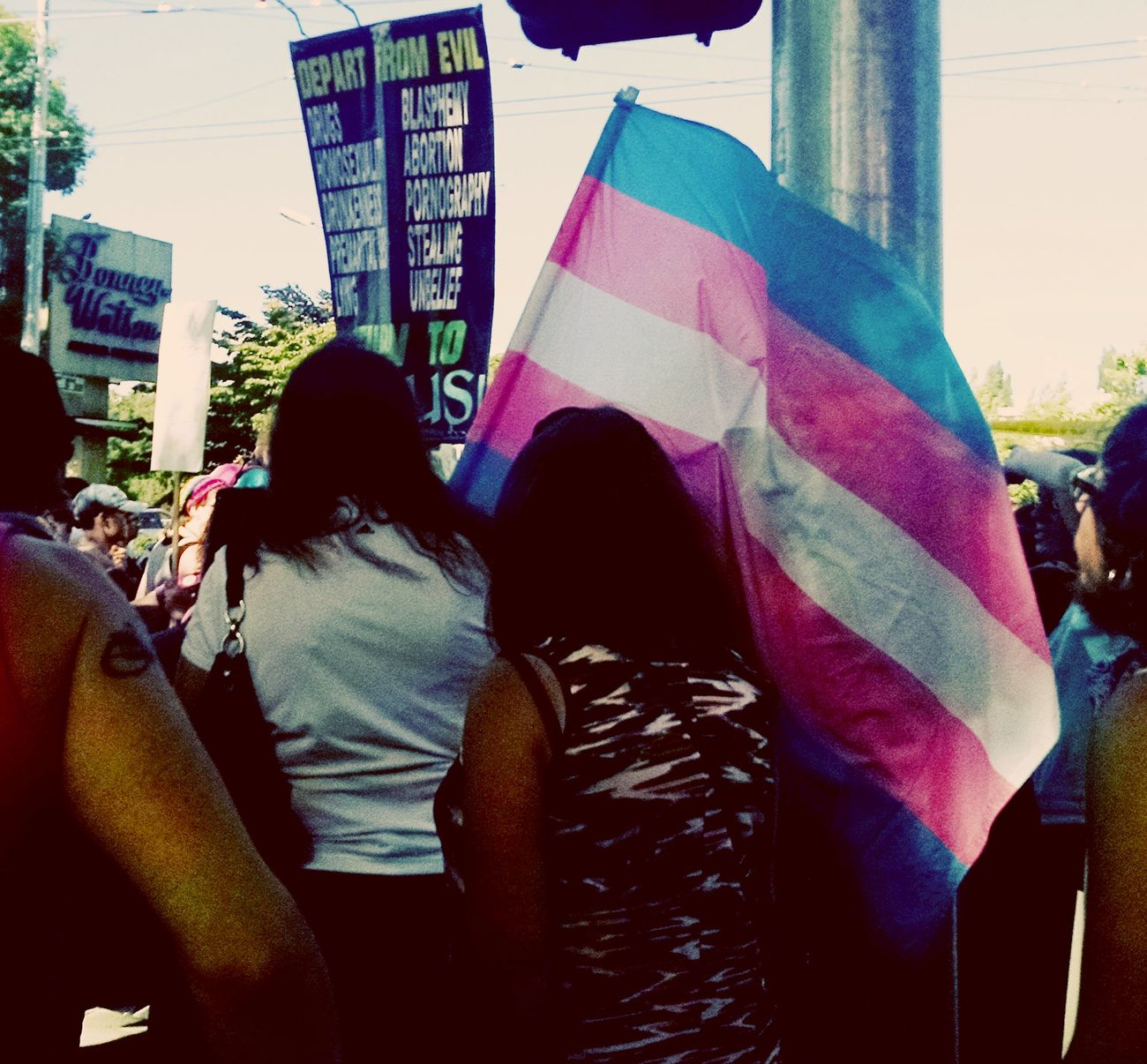 This photo was taken at Seattle's Trans Pride March while we waited for it to start. City Life City Street Day GenderEquality Lifestyles Outdoors Unity Unityindiversity Transgenderpride Transgender Against Homophobia The Photojournalist - 2016 EyeEm Awards