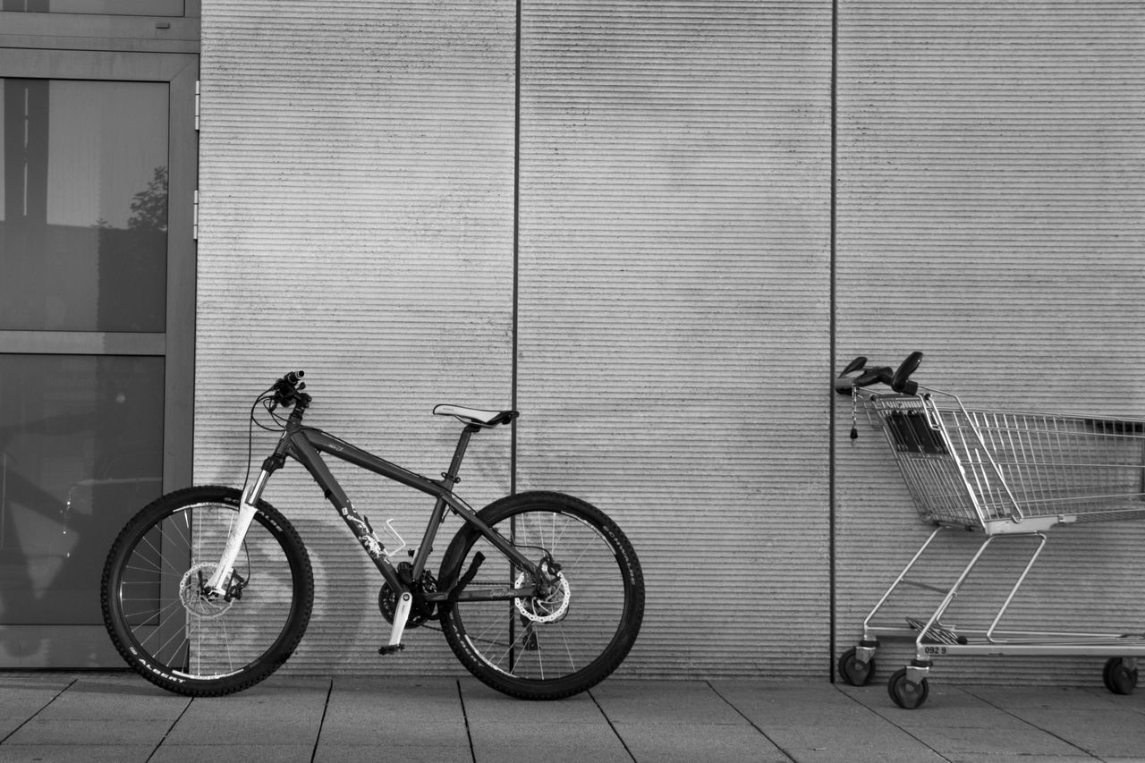 transportation, mode of transport, bicycle, day, stationary, outdoors, built structure, land vehicle, building exterior, architecture, no people, full length
