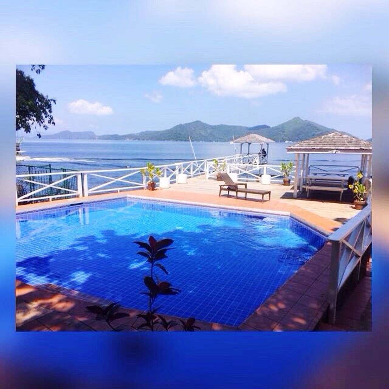 swimming pool, luxury, sea, mountain, water, tropical climate, tourist resort, luxury hotel, vacations, blue, travel destinations, tranquil scene, scenics, sky, nature, cloud - sky, no people, outdoors, day, holiday villa