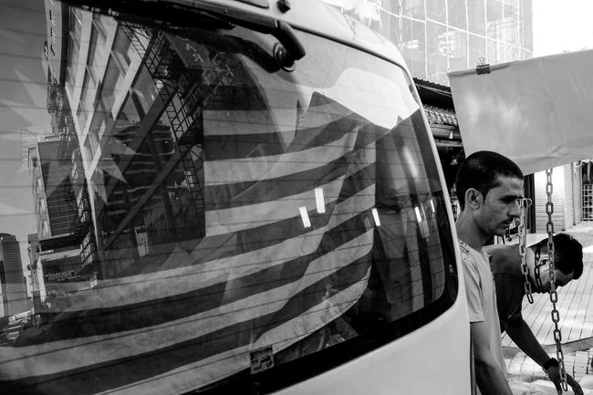 Street scene of migrant worker in Malaysia. Adult Architecture Bangladesh Black And White City Day Flag Horizontal Malaysia Men Migrant Workers One Man Only One Person Outdoors People Person Real People Staircase Steps Streetphoto_bw Streetphotography Walking Young Adult