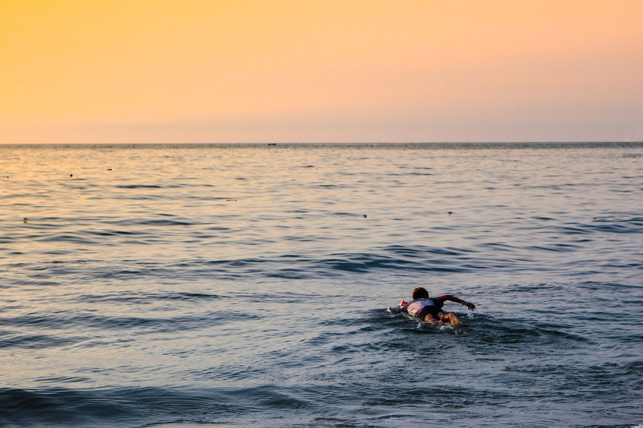 Swim into the ocean... Sunset Horizon Over Water Beach One Person Romantic Sky Humaninterest Sea Water Landscape Photography Wonderfulindonesia Live For The Story