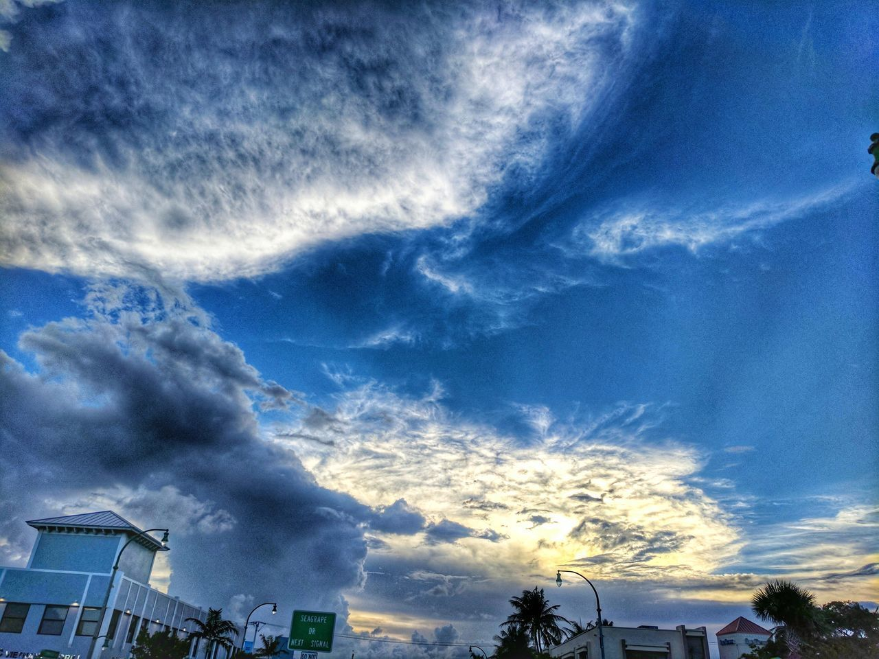 cloud - sky, sky, beauty in nature, low angle view, no people, nature, blue, outdoors, built structure, building exterior, scenics, day, architecture, tree, vapor trail
