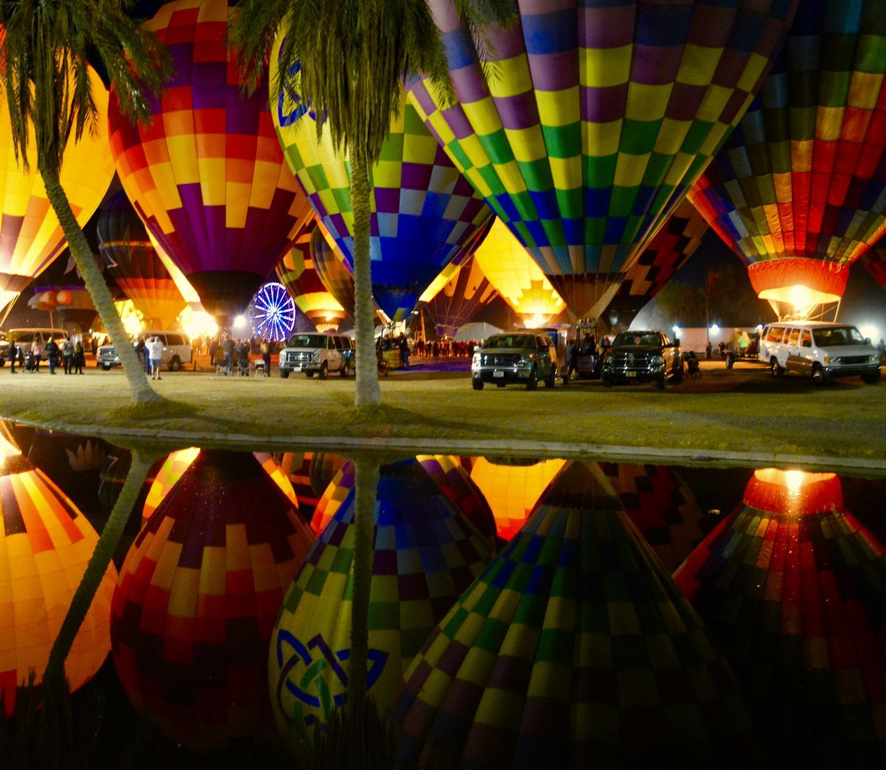 Hot air balloon festival Arizona Ballooning Festival Celebration Hot Air Balloons Illuminated Multi Colored Night Outdoors Reflection