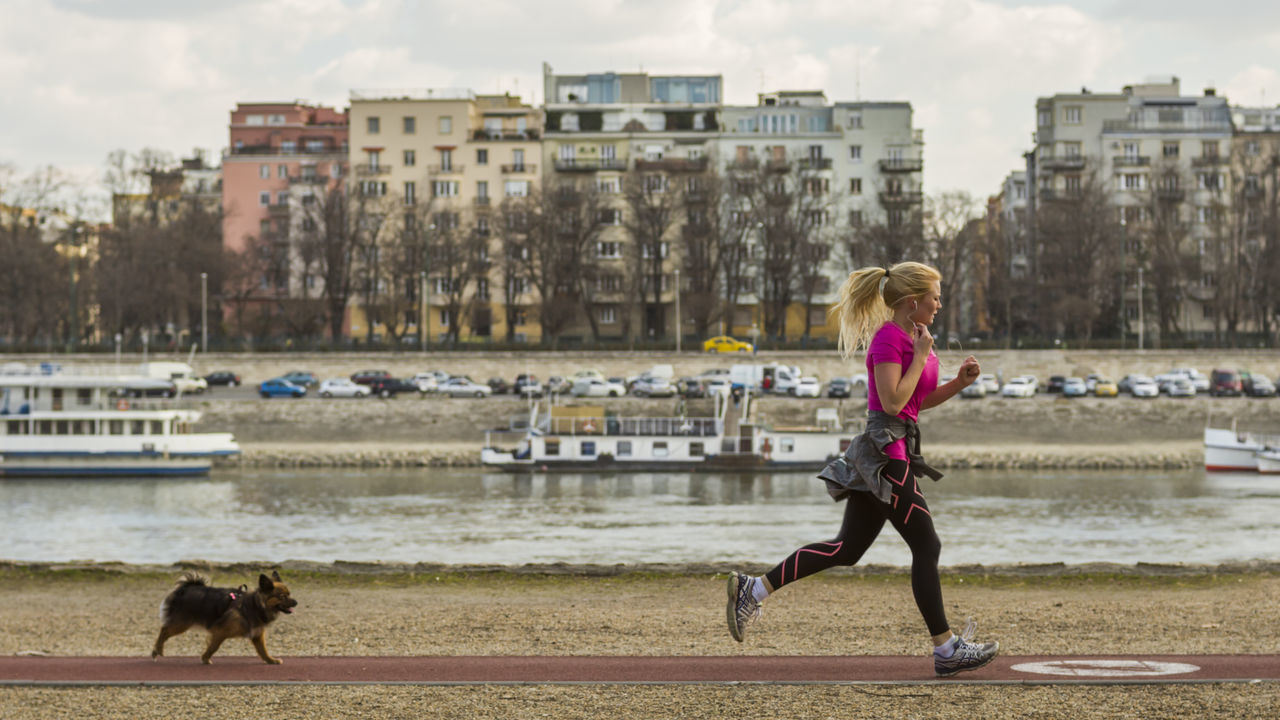 City Girl With Dog Healthy Lifestyle Here Belongs To Me Jogging Leisure Activity Lifestyles Run Runner Sport Sporty The Color Of Sport The Street Photographer - 2016 EyeEm Awards Woman