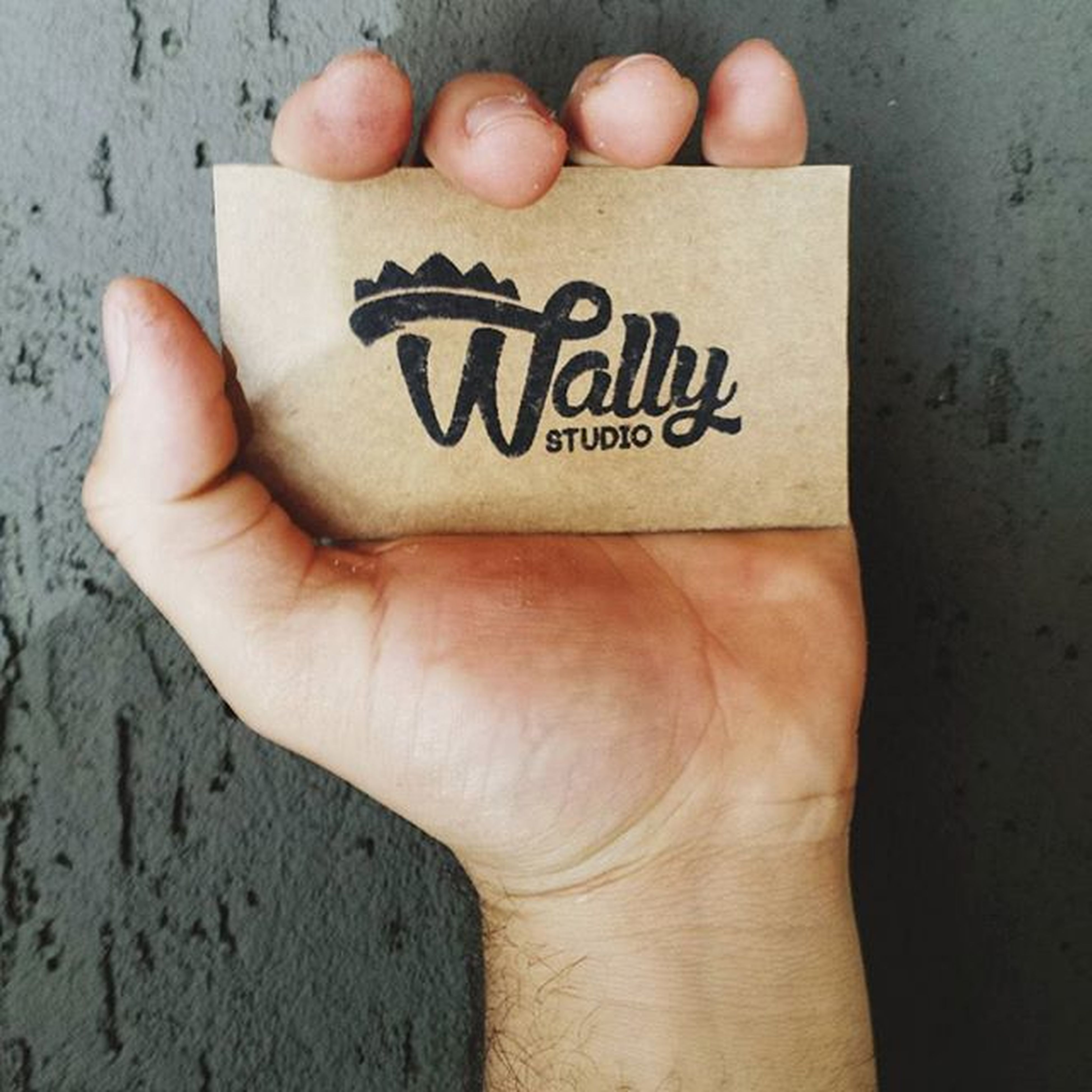 person, text, western script, communication, part of, human finger, holding, close-up, cropped, indoors, personal perspective, unrecognizable person, capital letter, wall - building feature, lifestyles, showing, non-western script