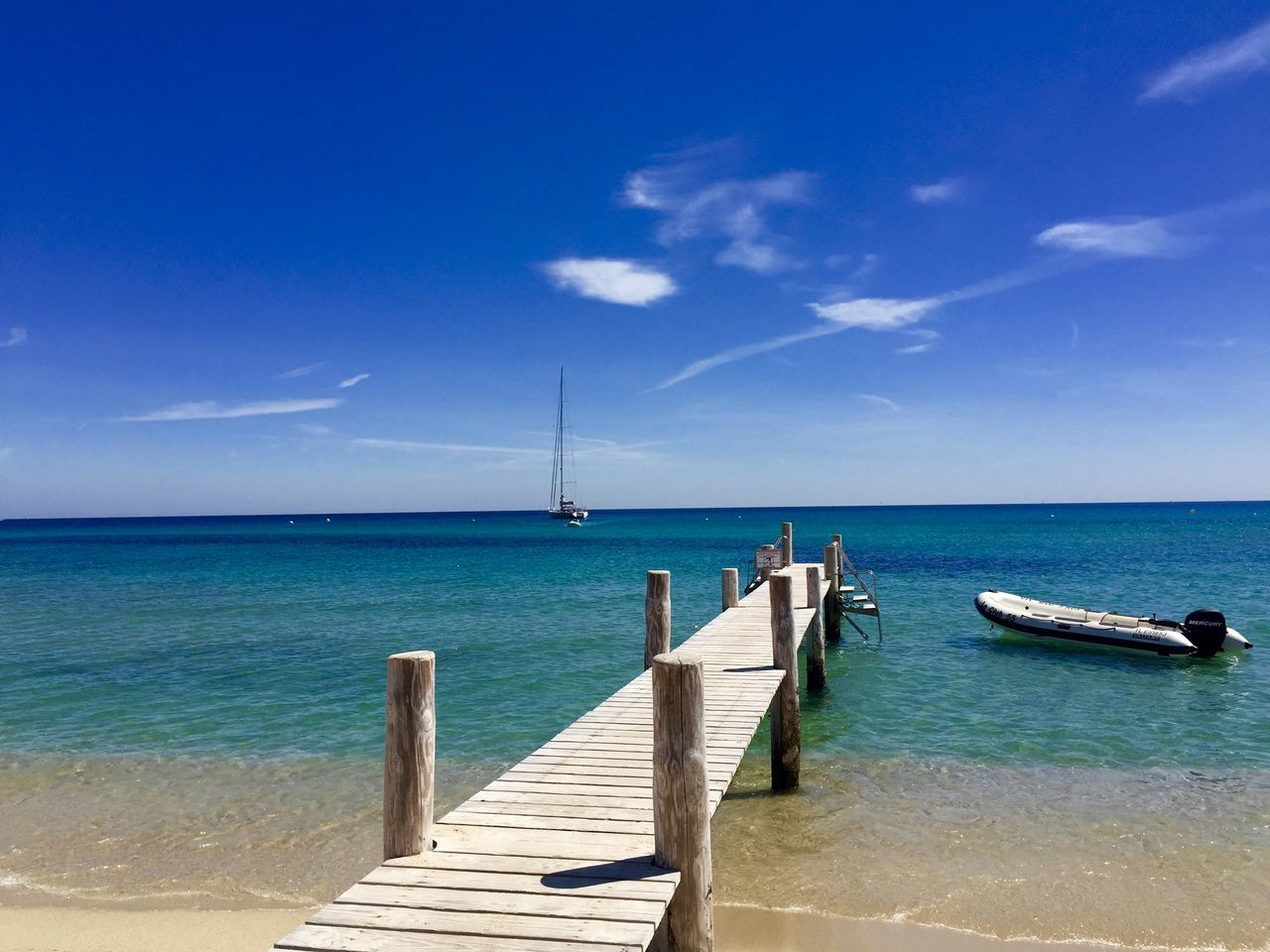 sea, horizon over water, sky, blue, water, beauty in nature, scenics, tranquility, sunlight, tranquil scene, nature, day, outdoors, no people, beach, nautical vessel