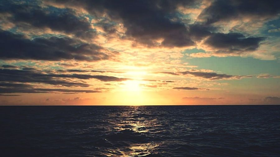 Sunset in the middle of the North sea looking towards Scotland Sunset Sea Scotland Northsea Water Sky Clouds First Eyeem Photo