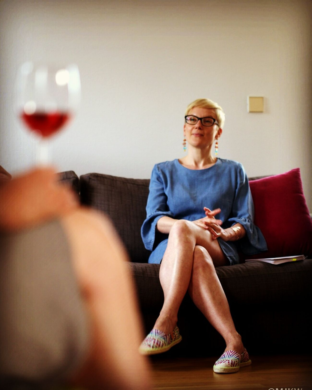 EyeEm Selects Woman Wineglass Sitting Wine Adult Eyeglasses  Indoors  Blonde Red Adults Only Red Wine One Person Lifestyles Full Length Drink Winetasting People