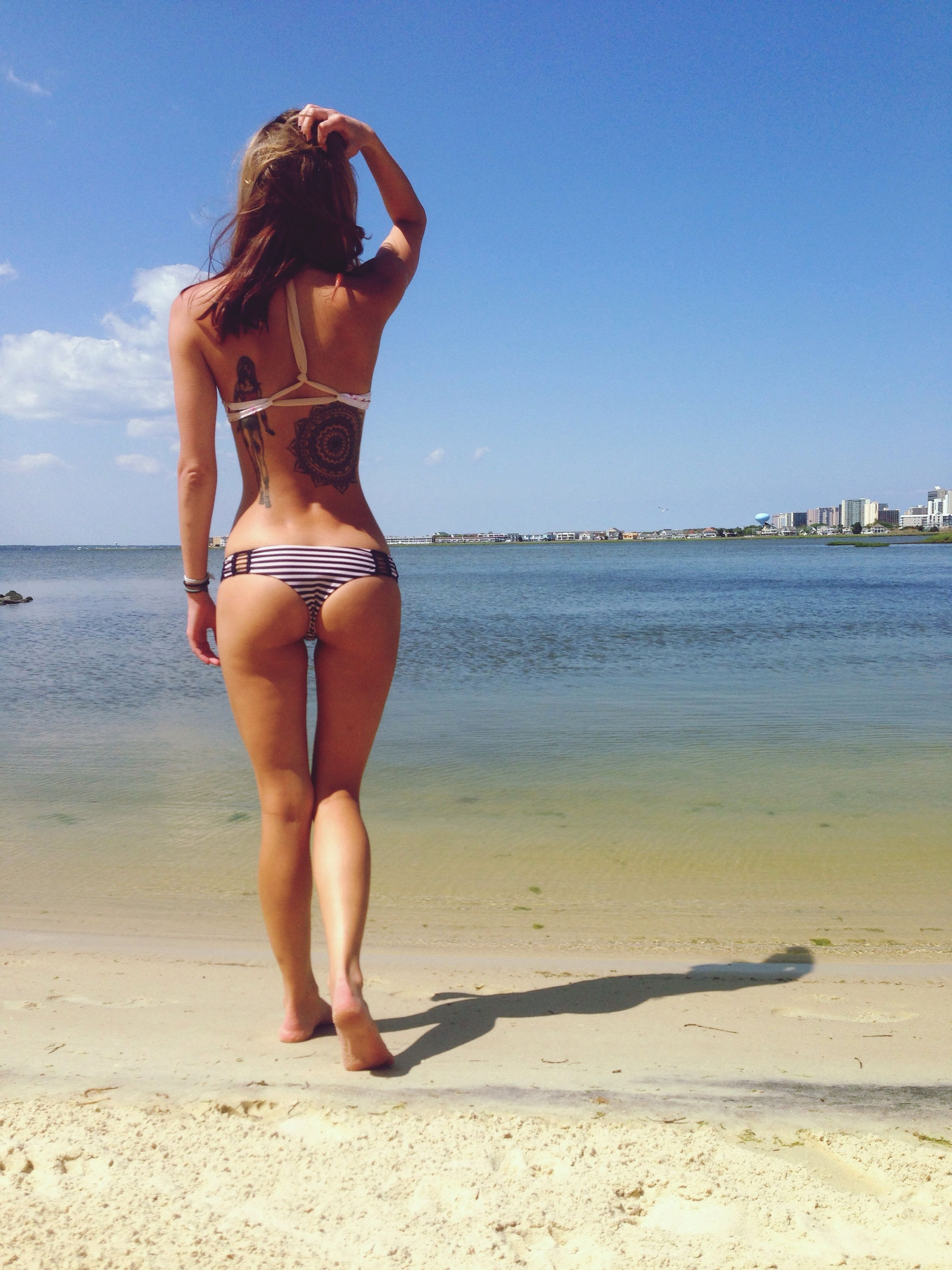 beach, sea, sand, water, shore, horizon over water, young adult, lifestyles, leisure activity, vacations, full length, clear sky, sky, summer, young women, standing, sunlight, bikini
