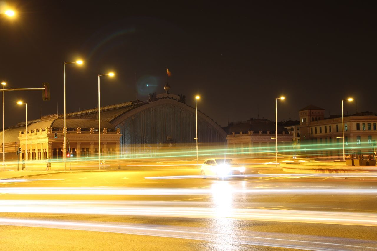 Illuminated Street Light Motion Speed Long Exposure Night Light Trail Transportation Blurred Motion Road Lighting Equipment City Life Outdoors Lit Lens Flare Tail Light Check This Out Hello World Atocha Madrid SPAIN Taking Photos Enjoying Life Nightphotography Capturing Motion