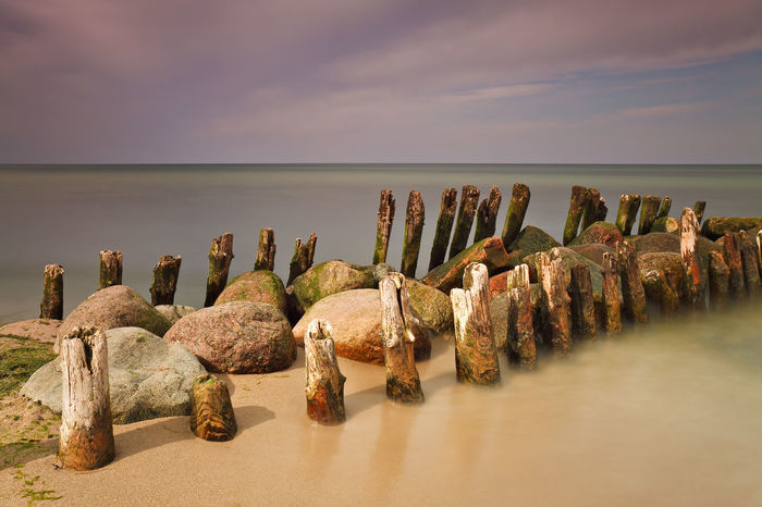Groynes on shore of the Baltic Sea. Baltic Sea Beach Beauty In Nature Cloud - Sky Coast Groyne Groynes Horizon Over Water Kühlungsborn Landscape Long Exposure Nature Nature Non-urban Scene Scenics Sea Seascape Shore Sky Stone - Object Tourism Tranquil Scene Tranquility Water Wood - Material