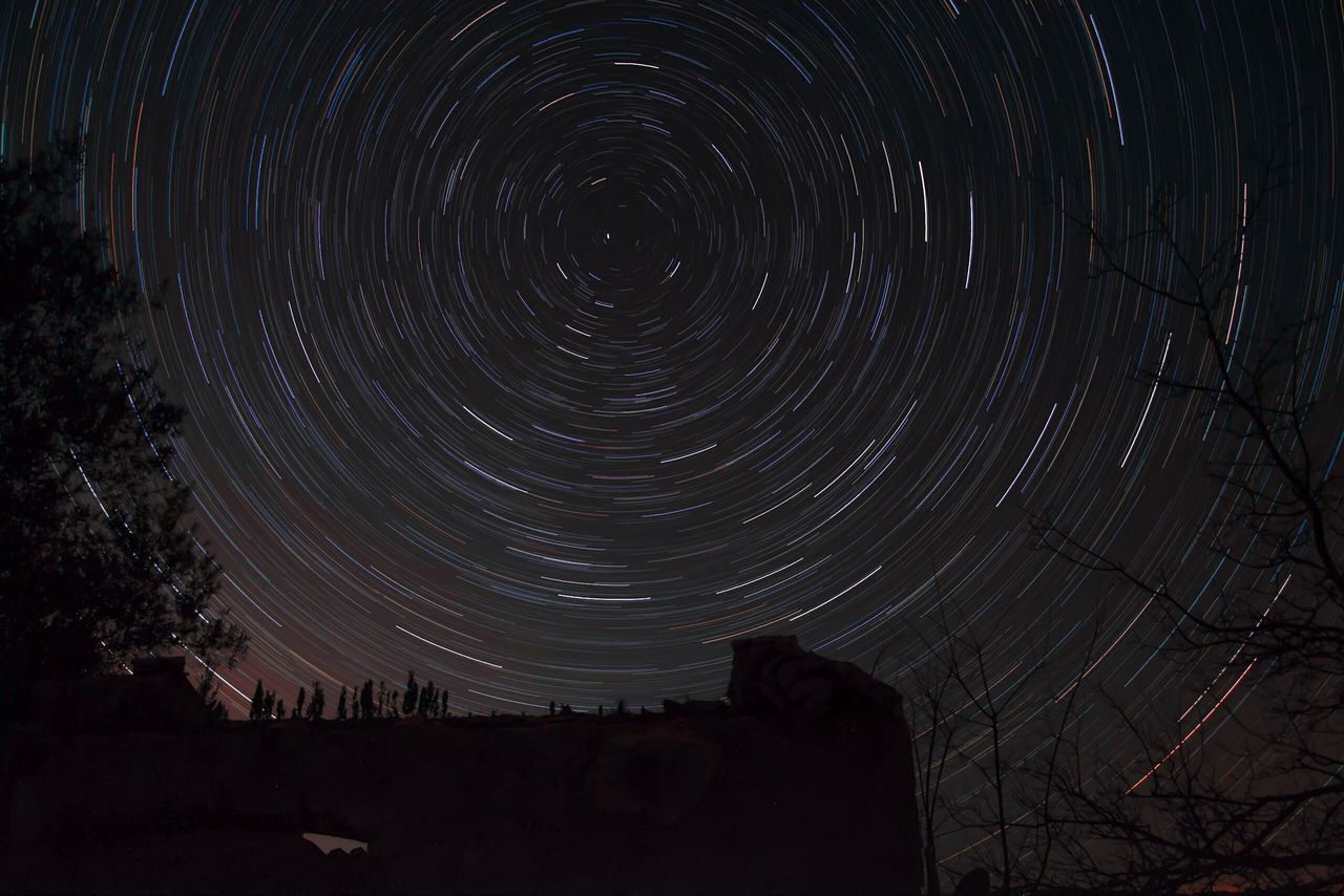 Star Trail Astronomy Building Ancient Architecture Tree Stars Colors Of Nature Star - Space Space Sky Scenics Motion Beauty In Nature Tranquil Scene Long Exposure No People Constellation Nature Star Field Outdoors Concentric Galaxy