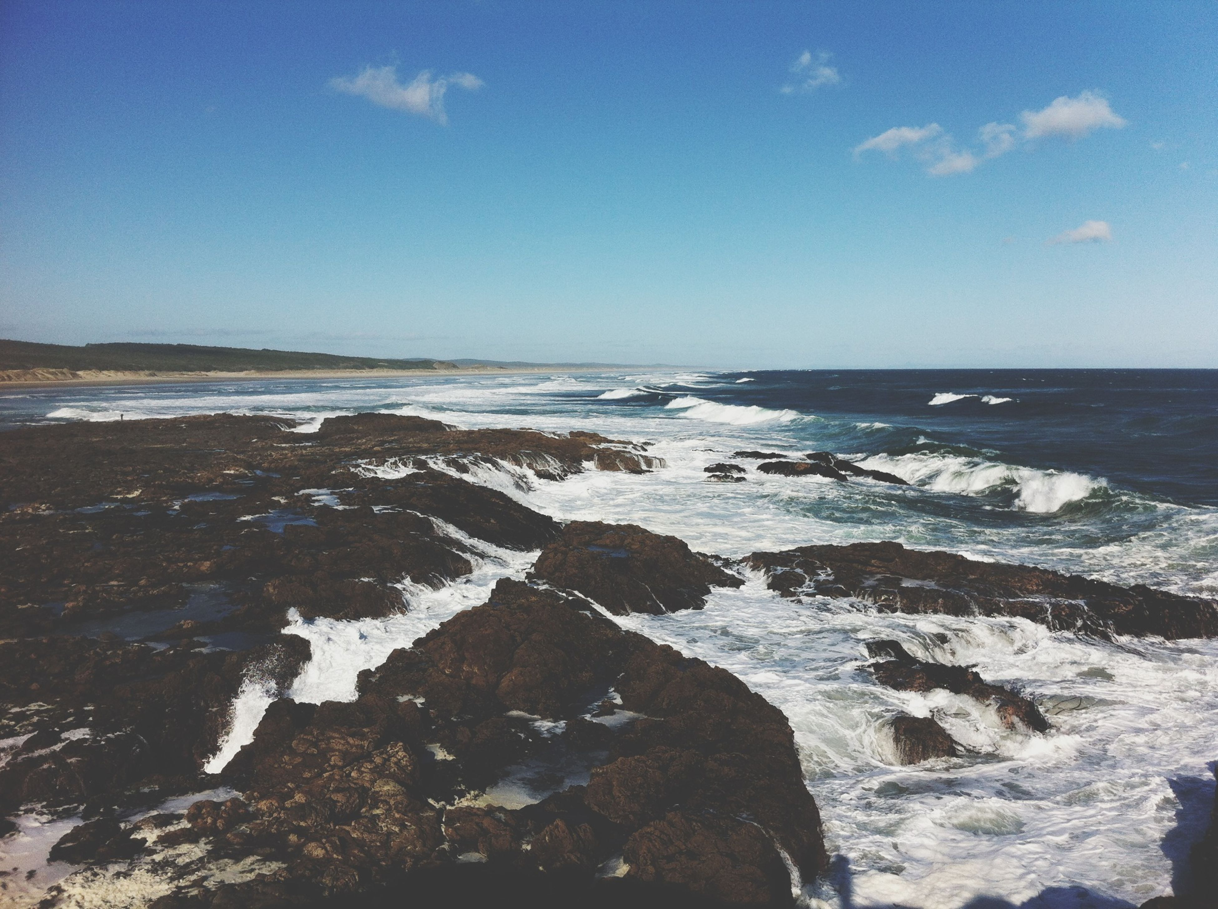 sea, water, horizon over water, beach, scenics, wave, tranquil scene, sky, beauty in nature, shore, tranquility, nature, surf, rock - object, idyllic, blue, outdoors, coastline, no people, day