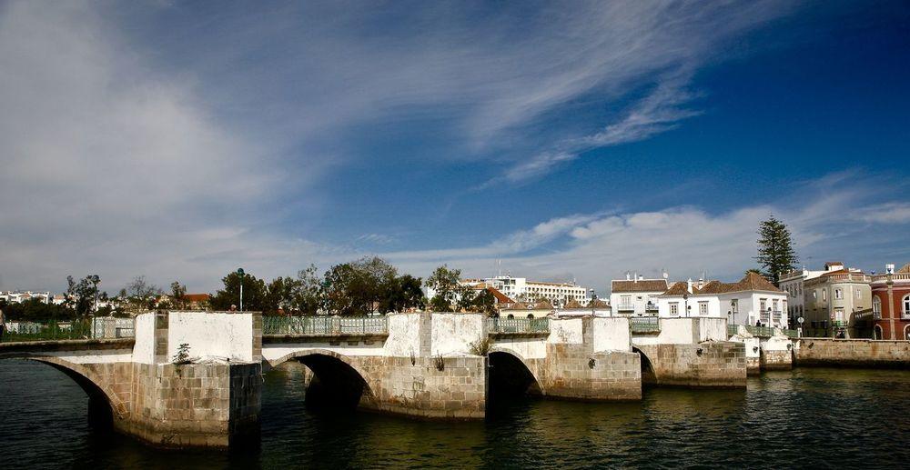 Old Roman Bridge in town centre. Architecture Bridge Built Structure Cloud Historic Outdoors River Sky Water