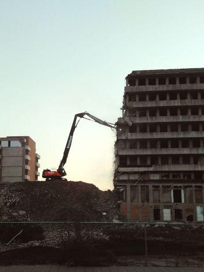 Demolition at dawn of an hospital in Zwolle, the Netherlands Demolition Site Zwolle Crane Dawn