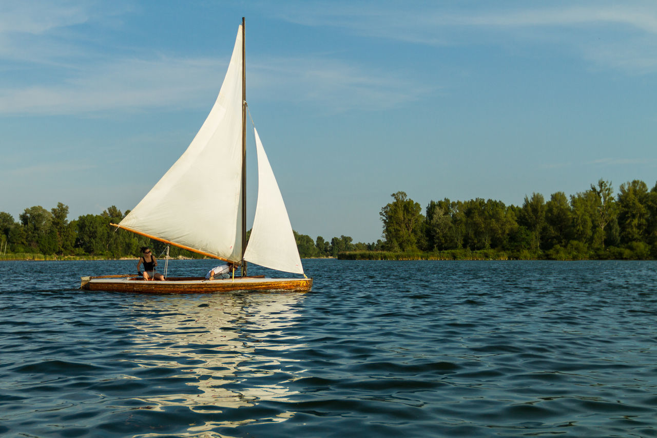 AlteDonau Beauty In Nature Day Lake Men Nature Nautical Vessel Outdoors People Real People Sail Sailboat Sailing Sailing Boat Sailing Ship Scenics Sky Tranquil Scene Tranquility Transportation Tree Water Waterfront