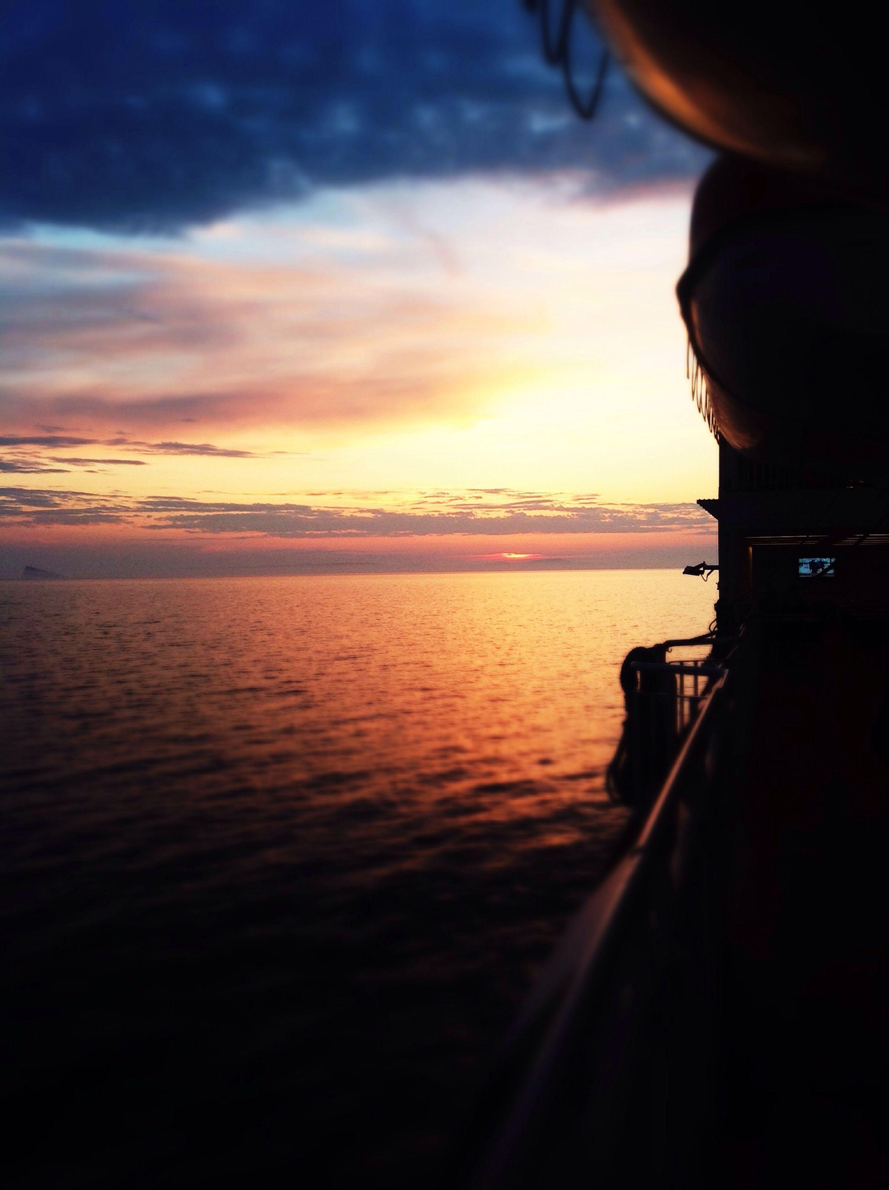 sunset, water, sky, sea, scenics, silhouette, beauty in nature, tranquil scene, orange color, horizon over water, tranquility, cloud - sky, nature, cloud, idyllic, reflection, transportation, rippled, dusk, dramatic sky