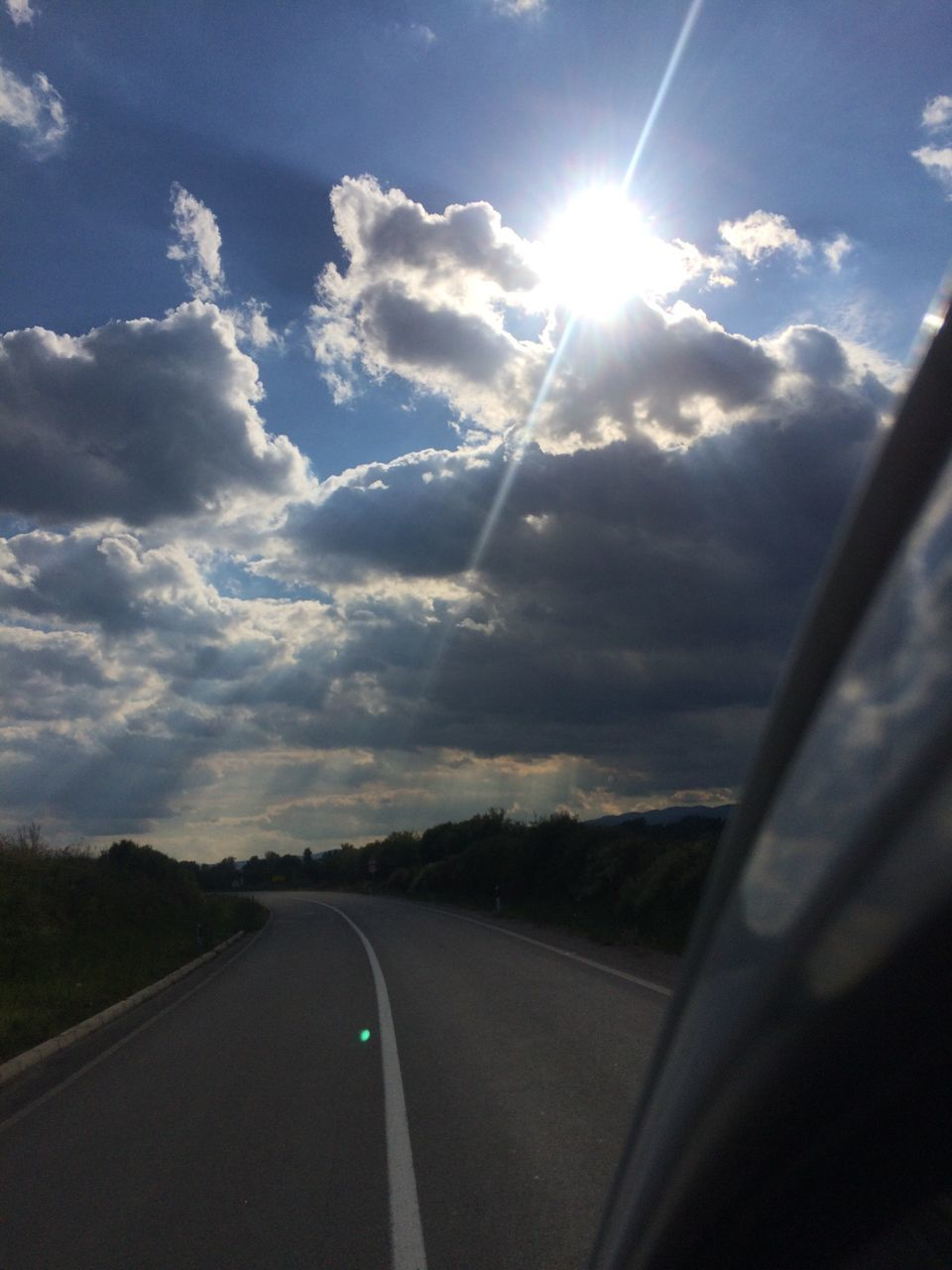 transportation, road, sun, lens flare, car, sunbeam, sky, sunlight, cloud - sky, the way forward, land vehicle, mode of transport, nature, no people, car interior, scenics, journey, sunset, day, car point of view, outdoors, beauty in nature, tree