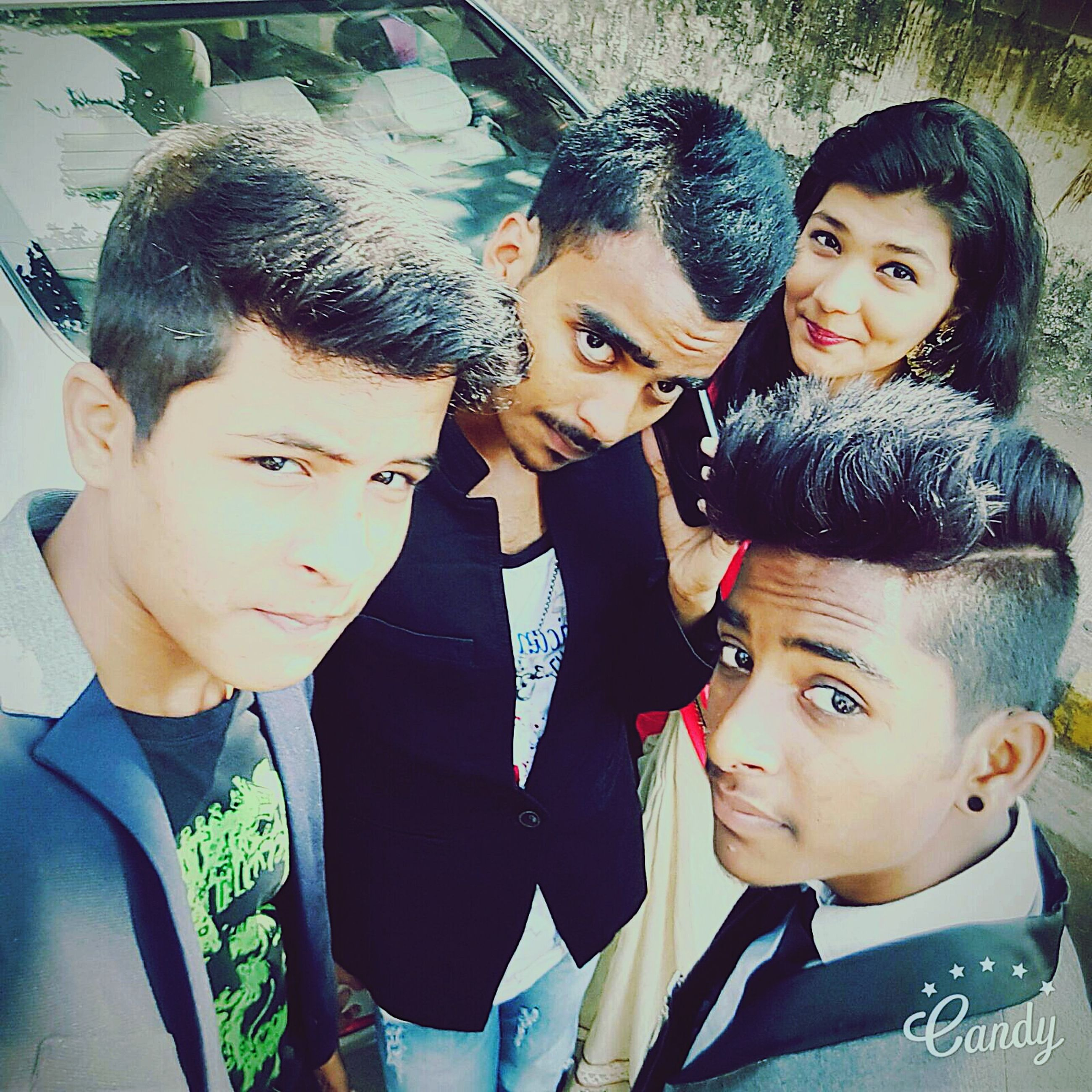togetherness, bonding, lifestyles, person, looking at camera, portrait, happiness, leisure activity, young adult, love, smiling, friendship, front view, young men, casual clothing, family, enjoyment