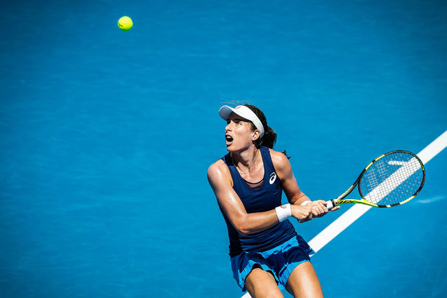 Johanna Konta plays a backhand during the 2017 Australian Open. Photo by Luke Hemer/Tennis Australia. Copyright Tennis Australia. Athlete Ball Blue Court Day Exercising Healthy Lifestyle Leisure Activity Lifestyles Mid-air Motion One Person Outdoors Playing Practicing Racket Racket Sport Real People Sport Sports Clothing Tennis Tennis Ball Tennis Racket Young Adult Young Women
