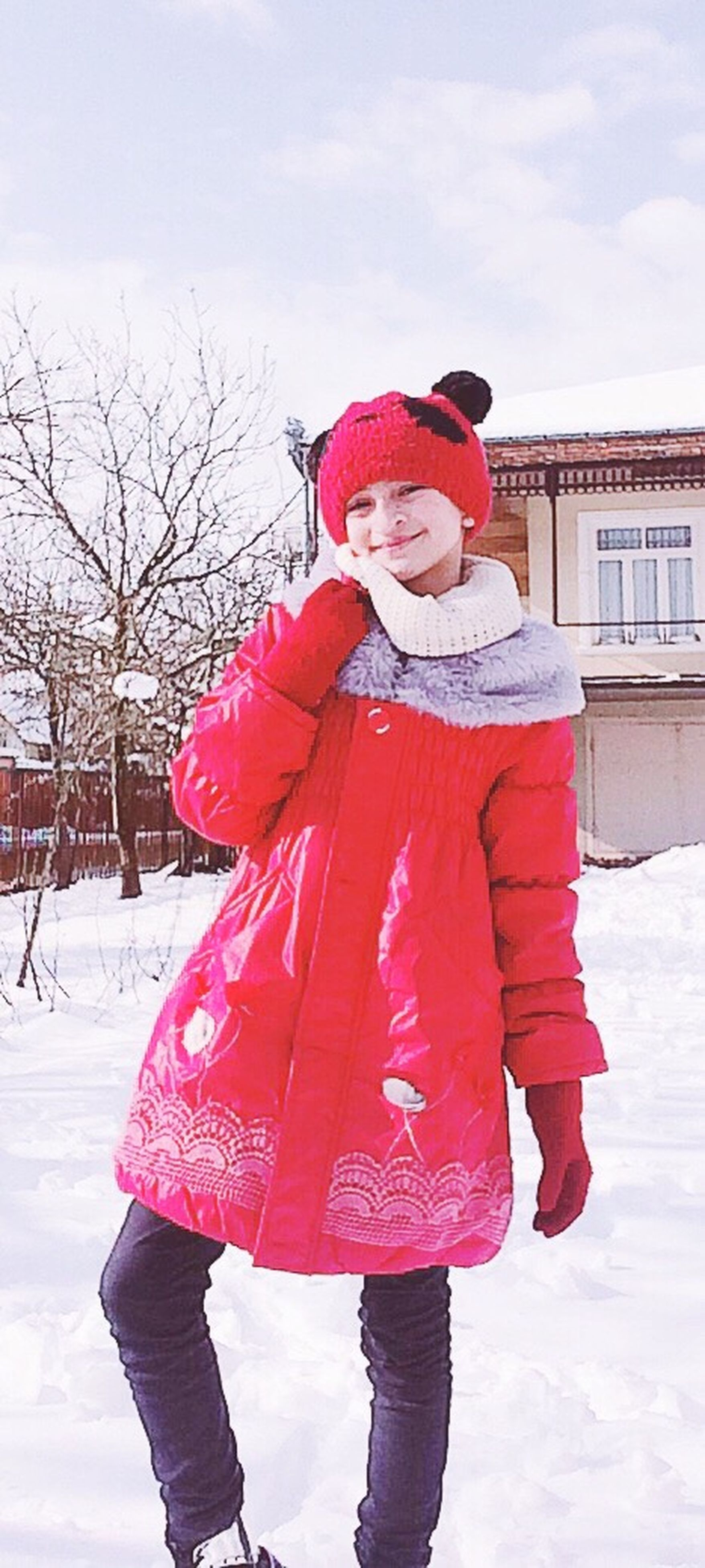 winter, cold temperature, snow, warm clothing, three quarter length, child, frozen, people, childhood, scarf, front view, outdoors, knit hat, standing, holiday - event, smiling, leisure activity, day, one person, cheerful, ice, nature, snowing, adult, sky