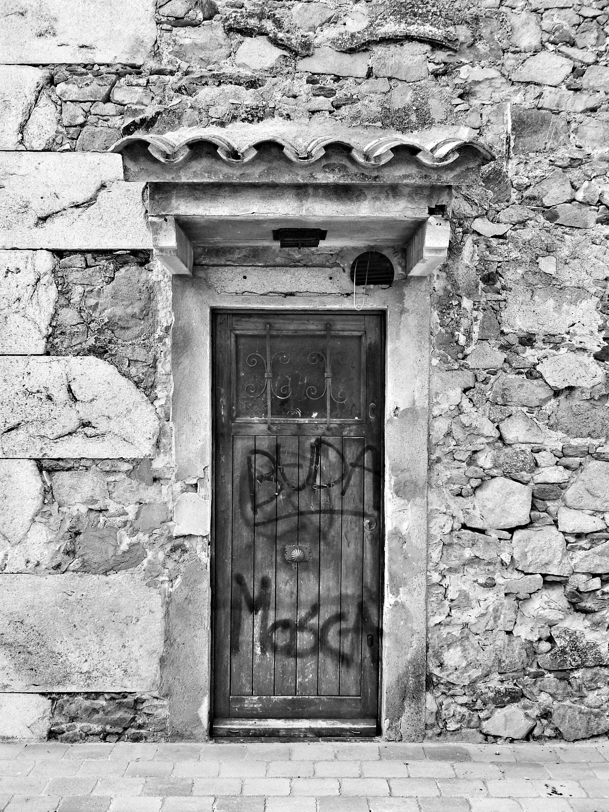 architecture, built structure, building exterior, door, closed, old, window, brick wall, wall - building feature, entrance, stone wall, weathered, wall, house, day, outdoors, no people, protection, facade, safety