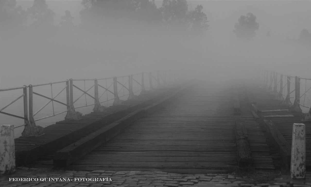 railing, fog, bridge - man made structure, outdoors, the way forward, day, connection, tranquility, nature, footbridge, water, no people, tree, beauty in nature, sky