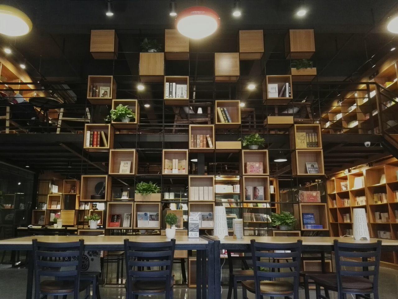 illuminated, indoors, no people, shelf, choice, night, bookshelf