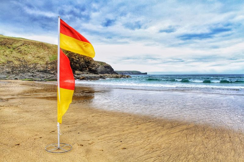 A lifeguard's warning flag for surfers and swimmers on a deserted Cornish beach. Coastal_collection Landscape_photography Seaside Ocean View Ocean Coastline Cornish Coast Cornwall Walks Cornwall Uk Cornwall Beach Beachphotography Lifeguard  Flag Warning Warning Sign Deserted Beach Seascape Seaside_collection Surfing Swimming RNLI