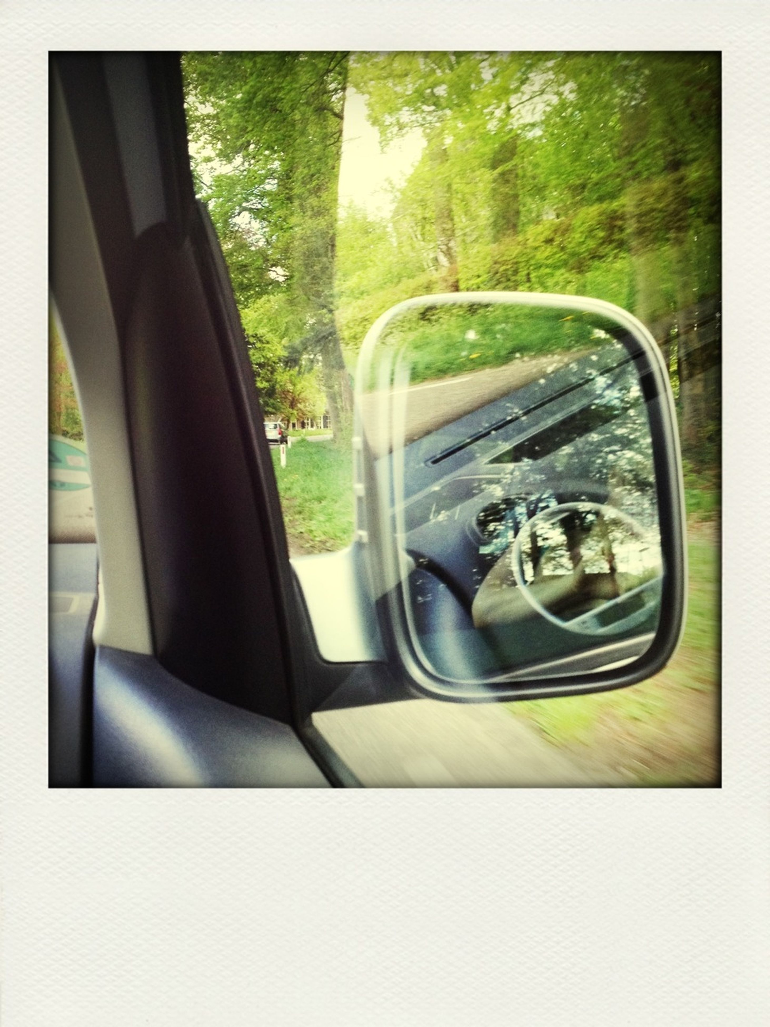 transportation, mode of transport, land vehicle, car, vehicle interior, travel, glass - material, tree, side-view mirror, reflection, transparent, car interior, on the move, windshield, window, journey, transfer print, part of, public transportation, road
