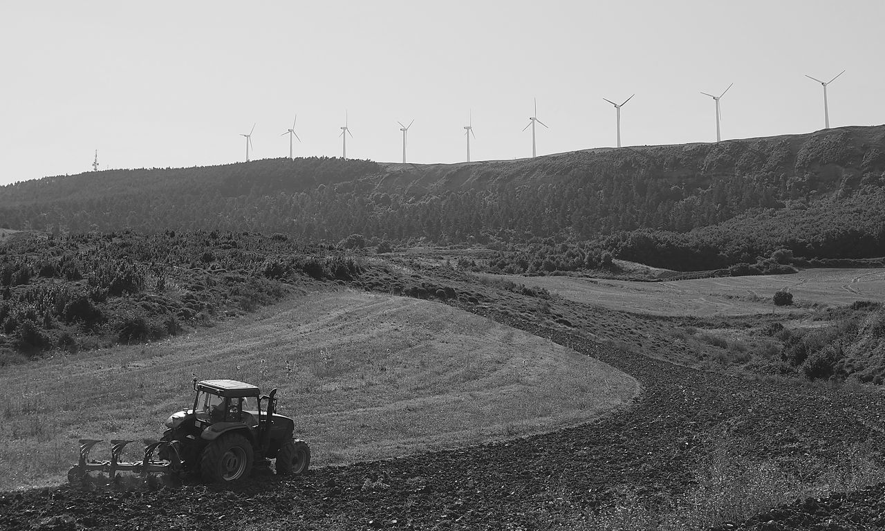 wind turbine, wind power, environmental conservation, fuel and power generation, alternative energy, renewable energy, field, windmill, rural scene, technology, day, outdoors, landscape, agriculture, nature, land vehicle, industrial windmill, sky, no people, beauty in nature, plowed field