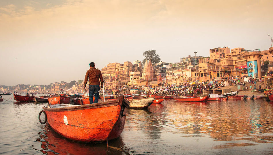 Sunrise liveliness in Varanasi Boat Built Structure Incredible India India Indiapictures One Person Orange Color Sunset Transportation Varanasi Varanasi, India Ganges, Indian Lifestyle And Culture, Bathing In The Ganges, Varanasidiaries Water Waterfront