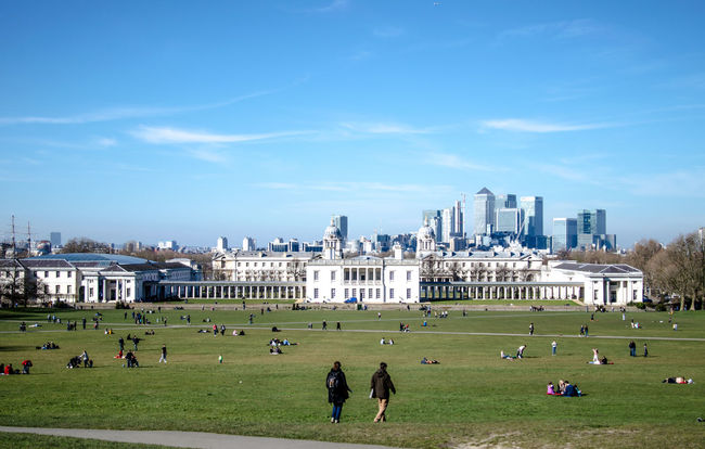 Architecture Blue Building Exterior Built Structure City City Life Cityscape Field Grass Grassland Grassy Green Color Greenwich Greenwich Park Large Group Of People Lawn London Relaxation Sky Skyline Skyscraper Urban Skyline