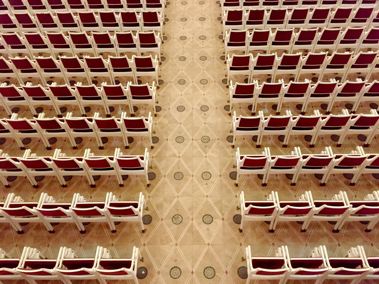 Absence Abundance Architecture Backgrounds Building Exterior Built Structure Chairs Close-up Concert Hall  Directly Above Full Frame In A Row In Order In Row Large Group Of Objects No People Outdoors Pattern Red Chair Seating Sitting Symmetry Theatre