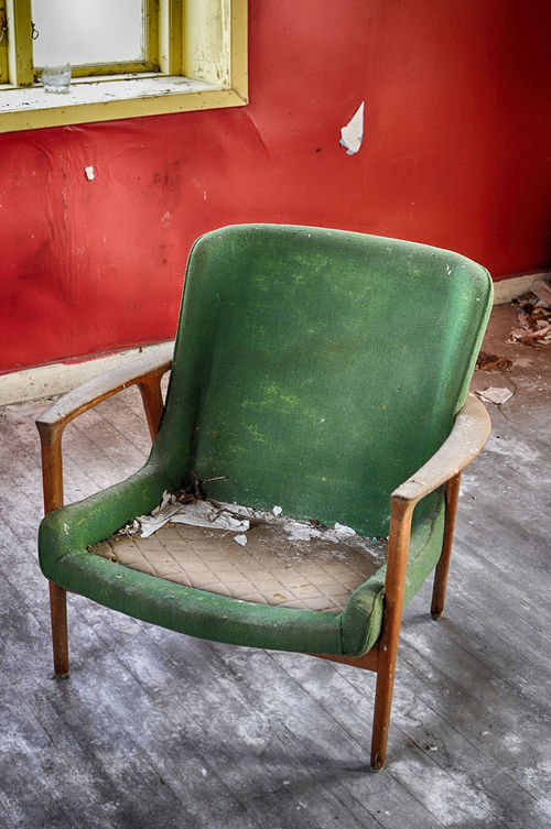 Abandoned room with old chair by the window. Abandoned Absence Armchair Broken Chair Close-up Colorful Day Dirty Domestic Room Empty Floor Furniture Green Color Messy No People Old Old Chair Red Room Seat Wall Window Wood - Material Wooden