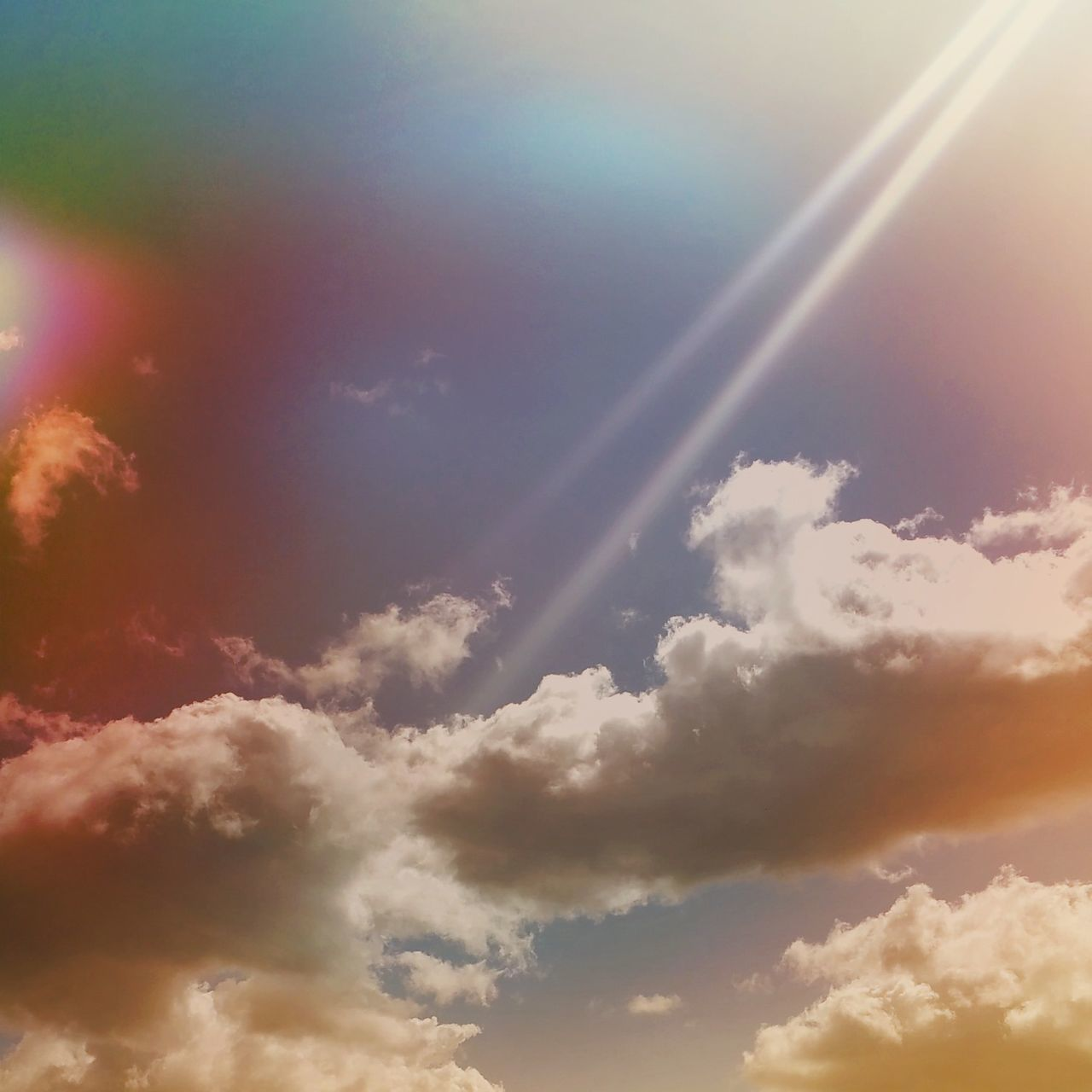 beauty in nature, nature, sky, majestic, scenics, sunbeam, tranquility, cloud - sky, no people, tranquil scene, outdoors, backgrounds, sky only, low angle view, sunset, day, contrail, vapor trail
