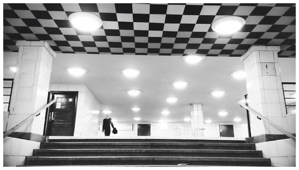 // walking large // Lookingup Walking Illumination Blackandwhite People Photography Streetphoto_bw Lerone-frames Lights Living Bold Black And White Architecture_bw Checkered White Album Blending Into The City Best Of Stairways