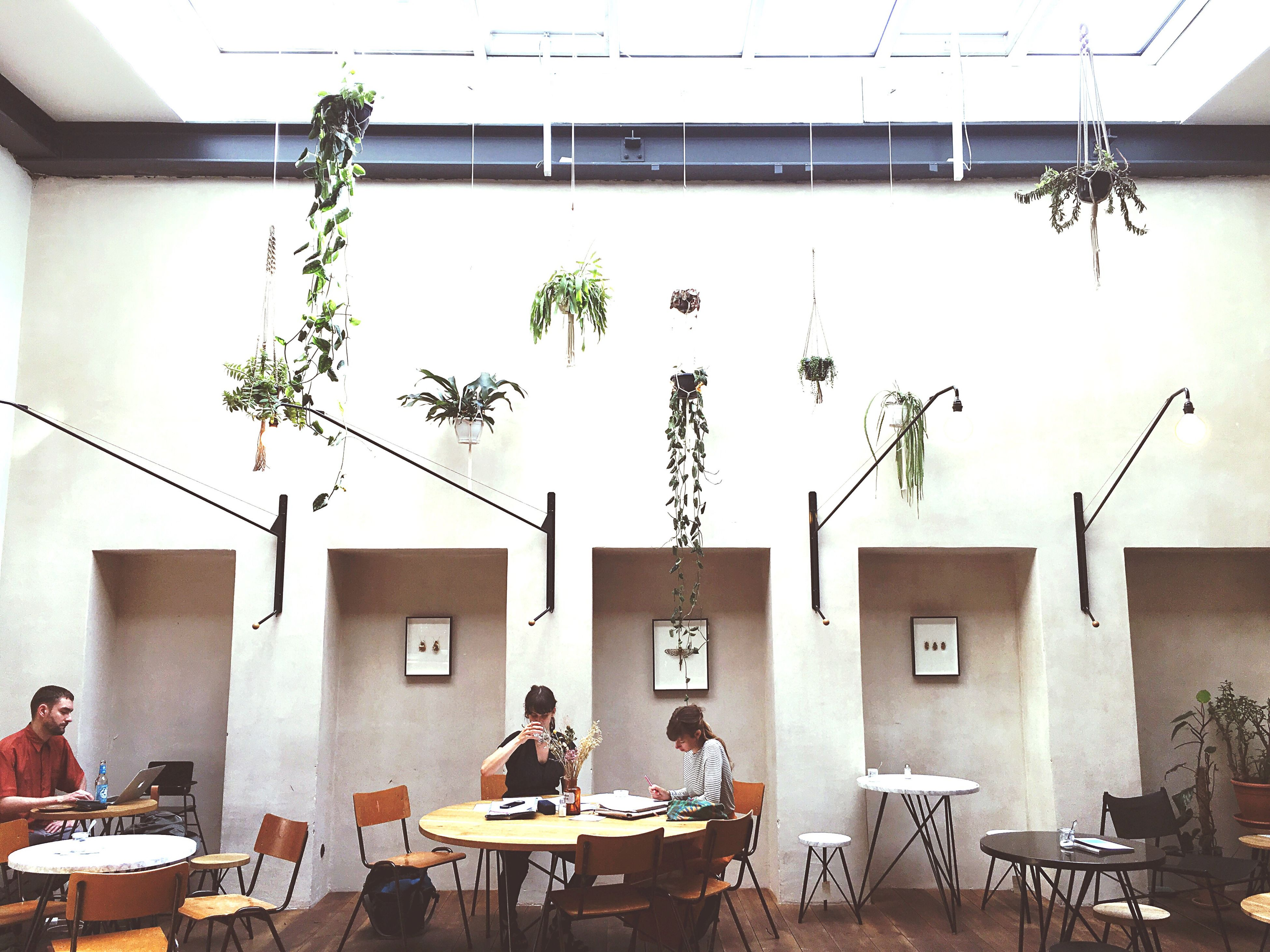 men, chair, table, architecture, indoors, lifestyles, built structure, person, sitting, leisure activity, building exterior, day, window, restaurant, relaxation, shadow, working, sunlight, high angle view
