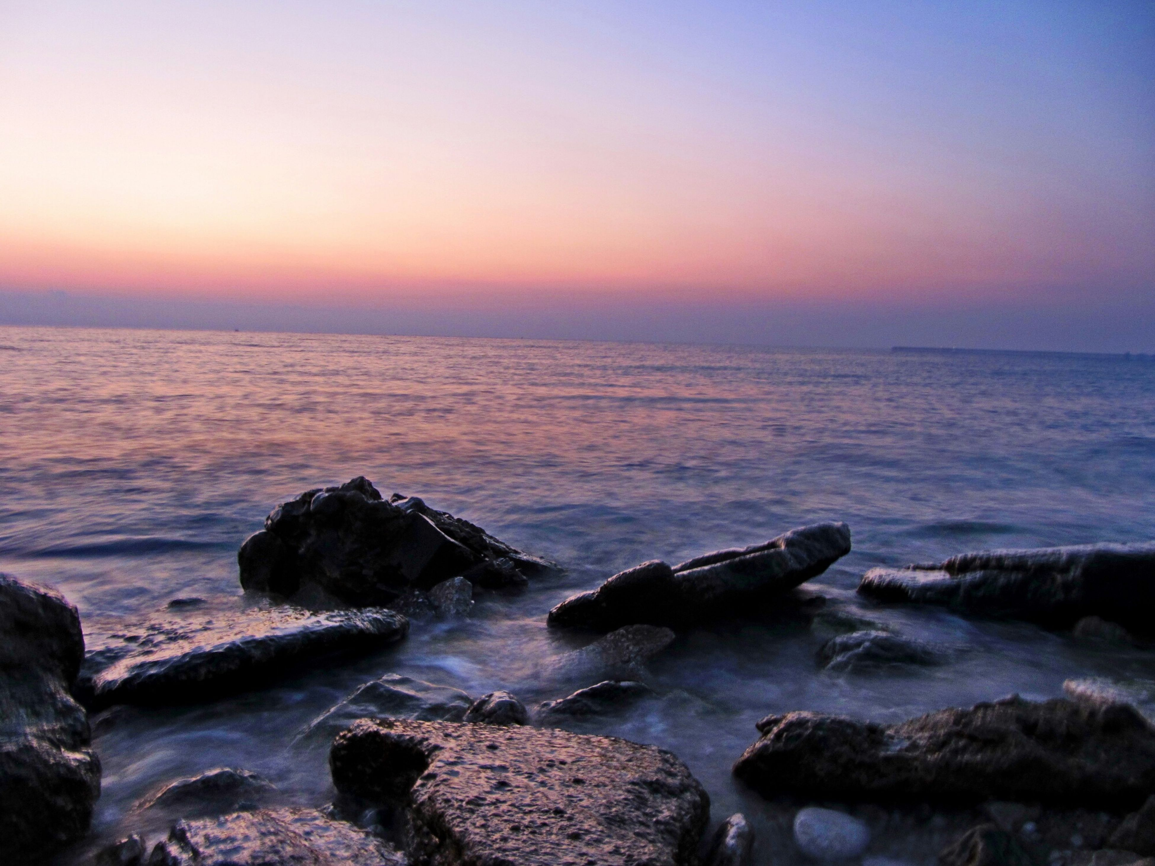 sea, water, horizon over water, scenics, rock - object, beauty in nature, tranquil scene, tranquility, sunset, nature, rock formation, wave, shore, sky, rock, idyllic, beach, clear sky, surf, outdoors