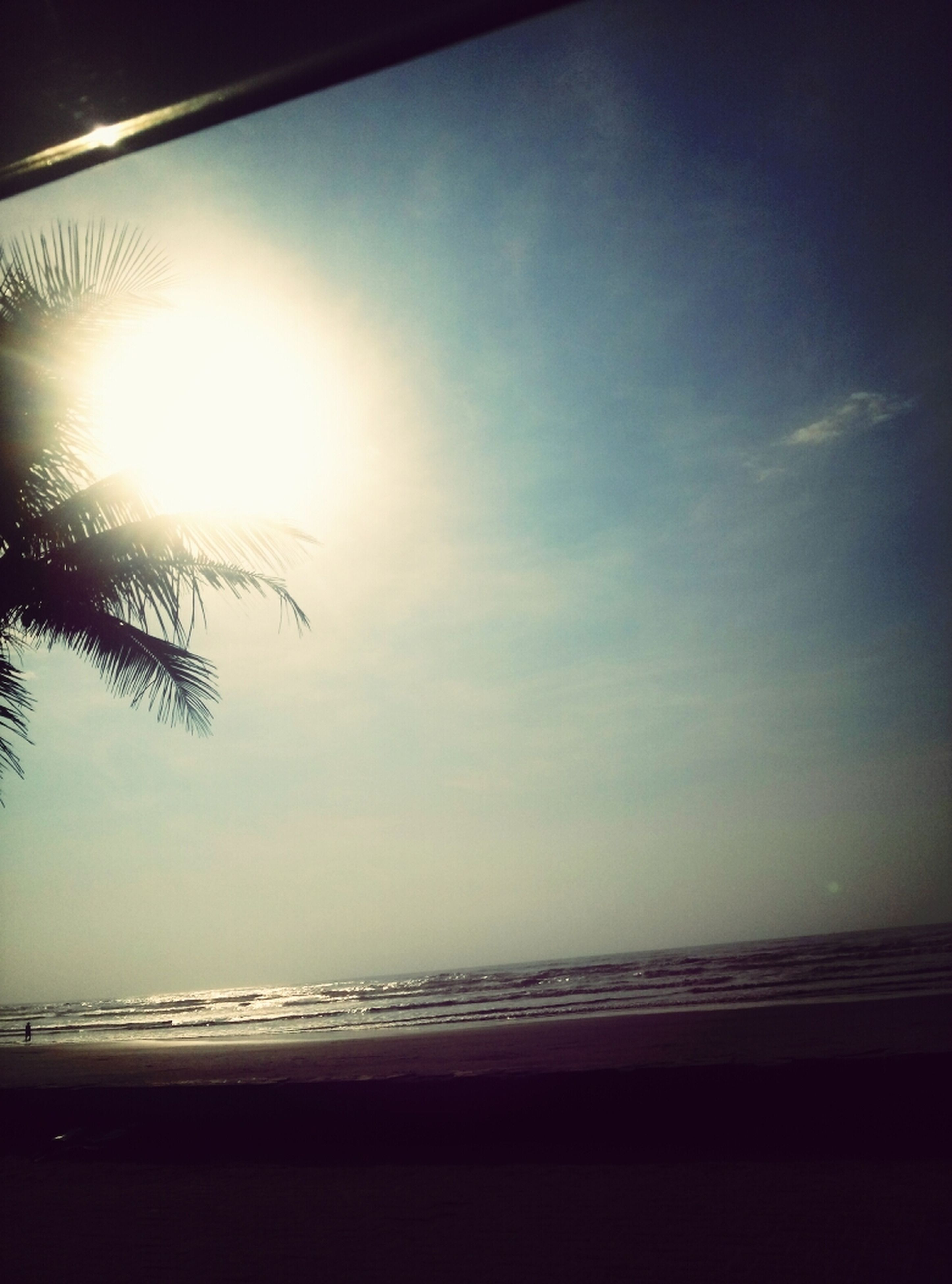 horizon over water, sea, beach, tranquil scene, tranquility, sun, scenics, water, sky, shore, sunset, beauty in nature, silhouette, nature, sand, sunlight, idyllic, sunbeam, calm, cloud - sky