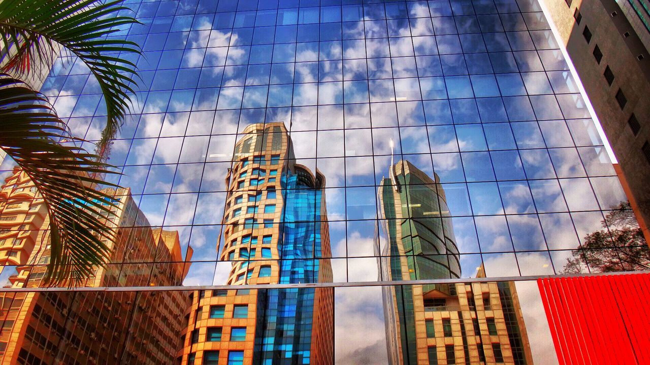 architecture, building exterior, built structure, low angle view, modern, window, skyscraper, reflection, day, no people, outdoors, city, sky