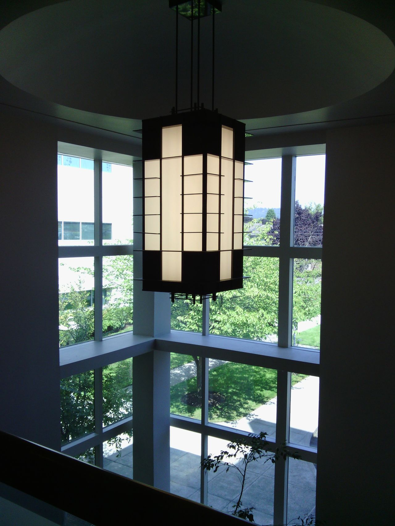 Lamp and window high in the lobby. Lamp Window Architecture Design