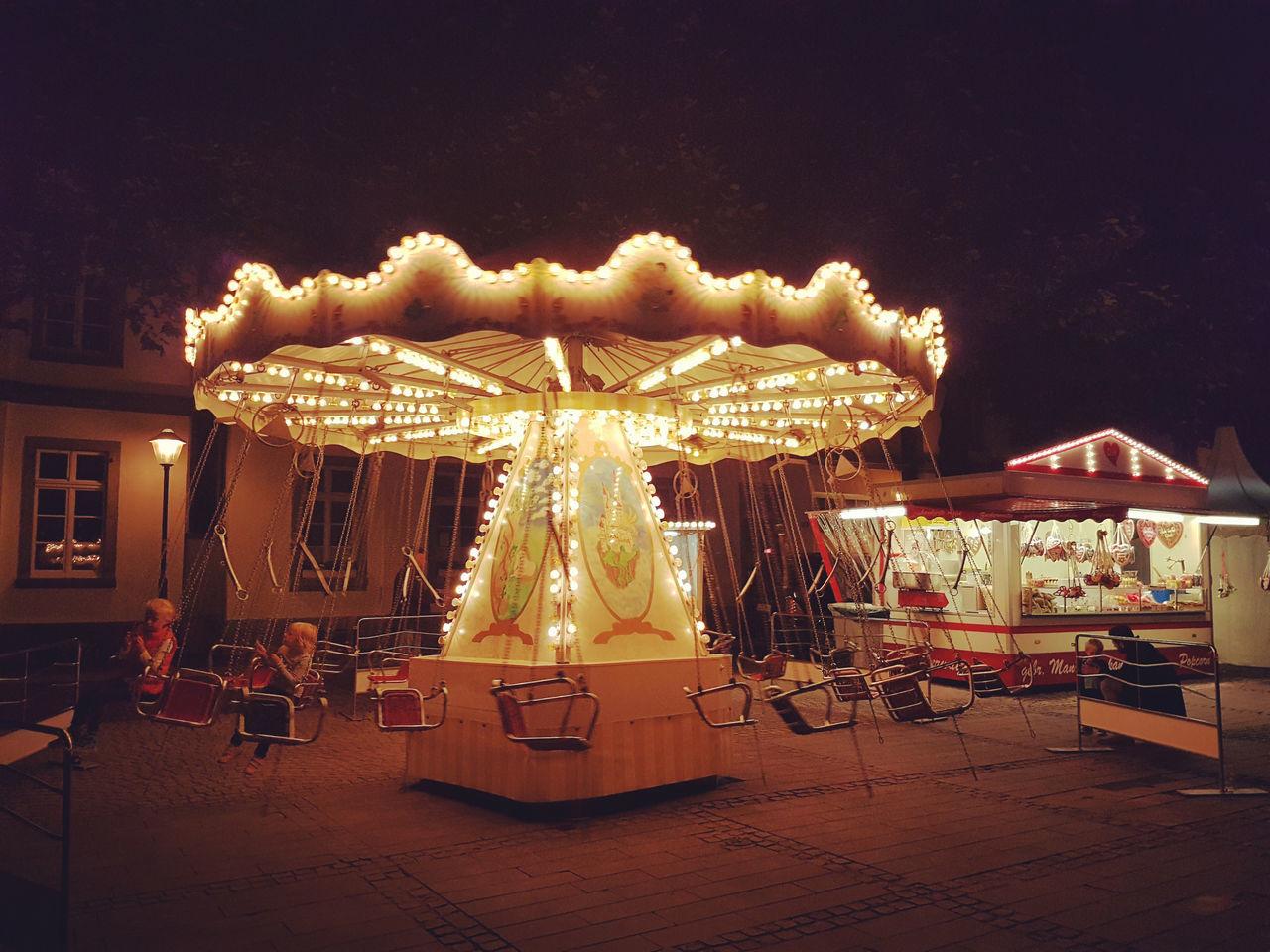 arts culture and entertainment, amusement park, night, illuminated, carousel, enjoyment, amusement park ride, chair, outdoors, fun, leisure activity, no people, merry-go-round, sky